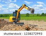 the modern excavator  performs...   Shutterstock . vector #1238272993