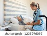 friendly nurse with senior... | Shutterstock . vector #1238296099