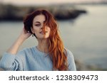 red haired woman on the... | Shutterstock . vector #1238309473