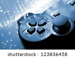 Small photo of Game controller and blue light