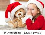 cute young girl wearing santa... | Shutterstock . vector #1238419483