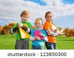 three kids standing with books... | Shutterstock . vector #123850300