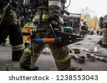 Small photo of Firefighters work on an extrication using a hydraulic rescue tool