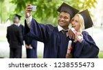 young people in graduation... | Shutterstock . vector #1238555473
