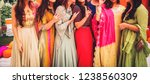 indian bride with bridesmaids... | Shutterstock . vector #1238560309