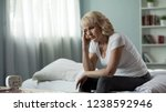 adult female sitting bed and... | Shutterstock . vector #1238592946
