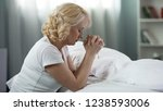 senior female sitting on the...   Shutterstock . vector #1238593006