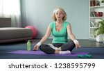 mature lady practicing yoga at... | Shutterstock . vector #1238595799