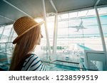 young woman in airport waiting... | Shutterstock . vector #1238599519
