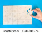 wooden puzzle on the blue... | Shutterstock . vector #1238601073