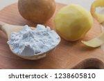 potato starch in a wooden spoon....   Shutterstock . vector #1238605810