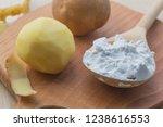 potato starch in a wooden spoon....   Shutterstock . vector #1238616553