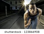Small photo of horizontal shot of black african american male running, urban setting with sun flare, motion blur, shows speed and determination, plenty of space for custom text
