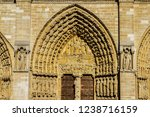 Small photo of Architectural fragments of Cathedral Notre Dame de Paris. Cathedral Notre Dame de Paris - most famous Gothic, Roman Catholic cathedral (1163-1345) on eastern half of Cite Island. France, Europe.