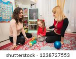 mother and girlfriend playing...   Shutterstock . vector #1238727553