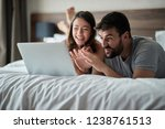 happy couple at home surfing... | Shutterstock . vector #1238761513
