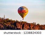 a colorful hot air balloon... | Shutterstock . vector #1238824303
