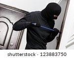 thief burglar opening metal...   Shutterstock . vector #123883750