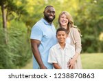 portrait of a mixed race family. | Shutterstock . vector #1238870863