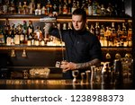 bartender pouring the cocktail... | Shutterstock . vector #1238988373