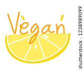 vegan text with yellow lemon... | Shutterstock .eps vector #1238989099