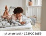 photo of relaxed dark skinned... | Shutterstock . vector #1239008659