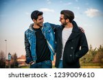 two handsome casual trendy... | Shutterstock . vector #1239009610