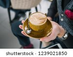 a cup of coffee in the hand of... | Shutterstock . vector #1239021850