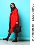 fashion woman in red coat.... | Shutterstock . vector #1239048970