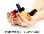 woman hands with nail polishes... | Shutterstock . vector #123907300