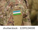 uzbekistan flag on soldiers arm ... | Shutterstock . vector #1239124030