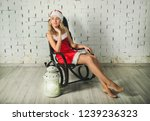 attractive snow maiden  in a... | Shutterstock . vector #1239236323