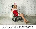 attractive snow maiden  in a... | Shutterstock . vector #1239236326
