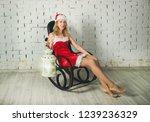 attractive snow maiden  in a... | Shutterstock . vector #1239236329