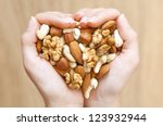 Various Nuts In Woman Hands ...