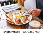 the man eat. knife and fork in... | Shutterstock . vector #1239367750