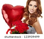 Stock photo beautiful female holding red roses bouquet valentines day 123939499