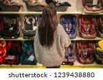 woman standing aganst shelf... | Shutterstock . vector #1239438880