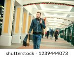 handsome young man doing his... | Shutterstock . vector #1239444073