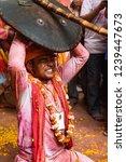 barsana  india   february 24 ... | Shutterstock . vector #1239447673