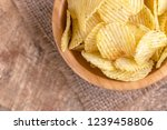 crunchy corrugated potato chips ... | Shutterstock . vector #1239458806