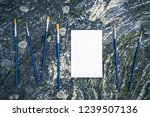 paintbrushes and white canvas... | Shutterstock . vector #1239507136