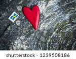 wooden red heart and swedish... | Shutterstock . vector #1239508186