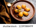 fried egg curry or anda masala... | Shutterstock . vector #1239588499