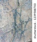 old cracked plaster. textured...   Shutterstock . vector #1239588703