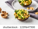 avocado halves stuffed with... | Shutterstock . vector #1239647500