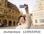 mature woman takes selfie on... | Shutterstock . vector #1239653920