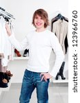 man in shop of clothes  smiles... | Shutterstock . vector #123966760