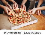hands of young people taking... | Shutterstock . vector #1239701899
