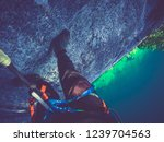 climber reaches the summit of a ... | Shutterstock . vector #1239704563